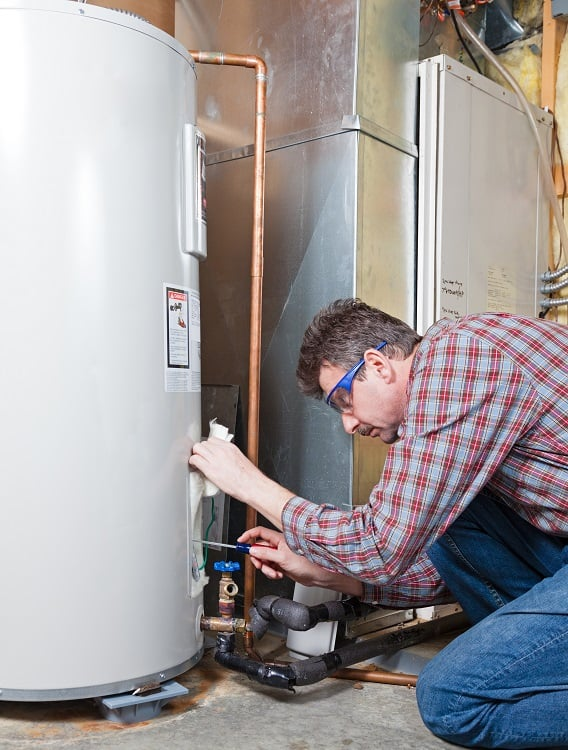 Man Setting Water Heater to Vacation Mode
